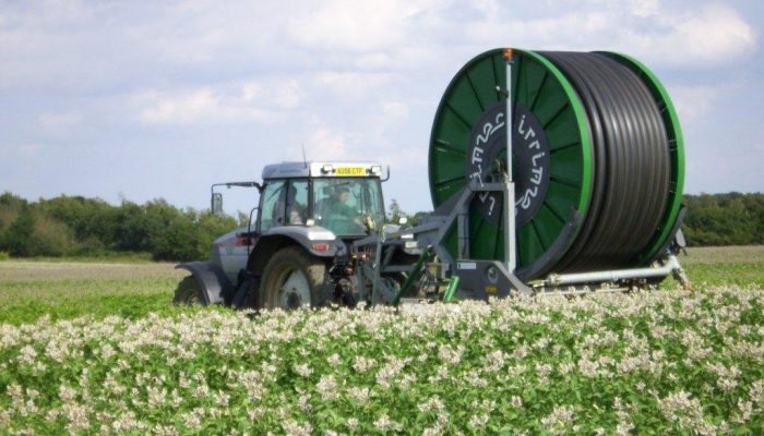 Ian moving an irrigator